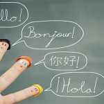 Hand with hello bonjour and other languages representing cultural and linguistic barriers